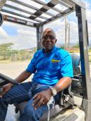 Alphonso Grennell sitting in his forklift that is used to teach students.