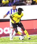 Jamaica's Shamar Nicholson (foreground), dribbles ahead of Honduran player Emilio Izaguirre in their Concacaf Gold Cup match held at the National Stadium on June 18, 2019.
