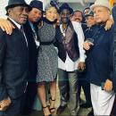 Trinity (left), with London crew members, including Dennis Alcapone, Winston Francis and female Japanese sax player, Megumi.