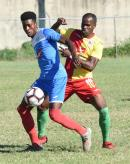 Shai Smith (left) of Portmore United shields the ball from Humble Lion's Levaughn Williams during their Jamaica Premier League match at the Spanish Town Prison Oval on Sunday, January 5, 2020.