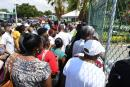 A crowd swarms the gate of St Joseph's Hospital in Kingston waiting to get the COVID-19 jab during the vaccination blitz on Monday.