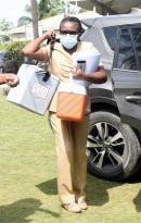 Public health nurse Novlette Stennett arriving at the Holy Trinity Anglican Church in Linstead, St Catherine, with an igloo with roughly  200 COVID-19 doses on Tuesday. The centre ran out of vaccines early in the morning, with some persons waiting more tha