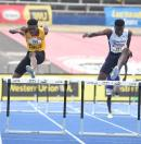 Jamaica College's Javier Brown (right) on his way to a record in the Class One Boys 400m hurdles, ahead of Devontie Archer of Excelsior High School, at the ISSA/GraceKennedy Boys and Girls' Athletics Championships at the National Stadium on Friday.