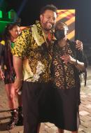 Dressed for the 'Jimmy Kimmel Live!' performance, entertainer Shaggy (left), embraces  Minister of Culture, Gender, Entertainment and Sport Olivia Grange.
