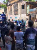 Police Commissioner Antony Anderson and National Security Minister Dr Horace Chang meeting with residents in a section of central Kingston yesterday. The area is tense after gang violence has caused a number of deaths in recent weeks.