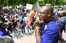 Joseph Patterson, president of the United Independent Congress (UIC), speaks to protesters who marched from St William Grant Park near Ward Theatre in downtown Kingston on Wednesday, September 22.